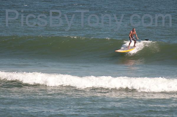 Folks Paddle Boarding Surfing at Northside of Pier in  Flagler Beach, FL on 10/13/2013