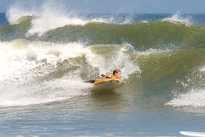 Lucas shreds on his body board