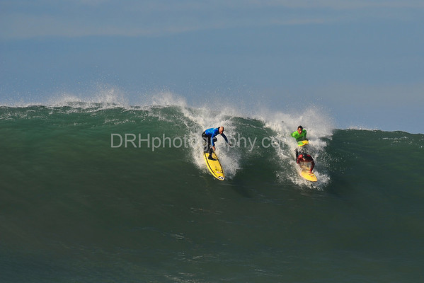 12 January 2008: Tyler Smith (blue), Anthony Tashnick (green), and Ryan Seelbach (red) during the semifinals of the 2008 Mavericks Surf Contest in Half Moon Bay, CA.