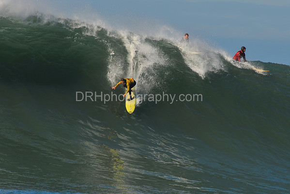 """12 January 2008: Grant """"Twiggy"""" Baker (yellow), Evan Slater (white), and Ryan Seelbach (red) during the semifinals of the 2008 Mavericks Surf Contest in Half Moon Bay, CA."""
