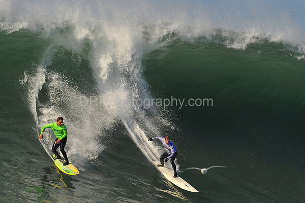 12 January 2008: Anthony Tashnick (green) and Evan Slater (white) during the semifinals of the 2008 Mavericks Surf Contest in Half Moon Bay, CA.