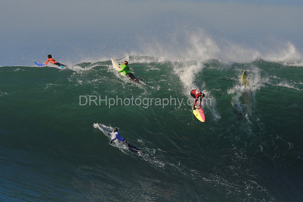 12 January 2008: Greg Long (orange), Evan Slater (green), Jamie Sterling (red), and Grant Washburn (white) during the 2008 Mavericks Surf Contest in Half Moon Bay, CA.