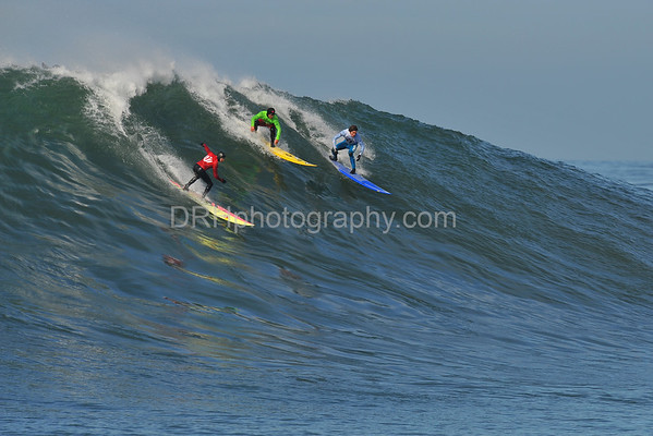 12 January 2008: Jamie Sterling (red), Dave Wassel (green), and Greg Long (white) during the semifinals of the 2008 Mavericks Surf Contest in Half Moon Bay, CA.