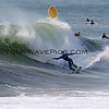 2018-12-18_Seal Beach SS_Brad_Domke_12.JPG<br /> <br /> Pro skimboarder, Brad Domke, started out on a yellow soft top surfboard and then switched mid-wave to a skimboard on the south side of the Seal Beach Pier.