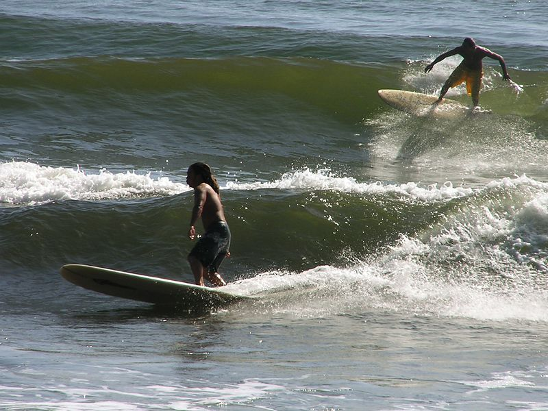 Surfers at Honolii