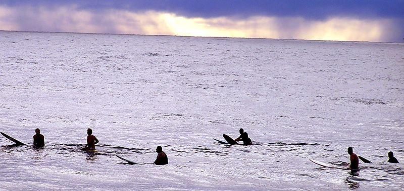 Surfers at Honolii