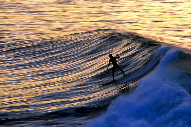 Sunrise surfing, Steamer's Lane, Lighthouse Point, Santa Cruz, California