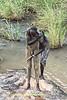 Suri Men Alongside A Stream