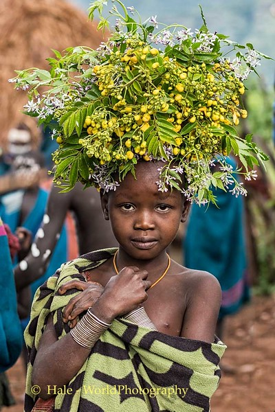Suri Young Girl With Head Dress