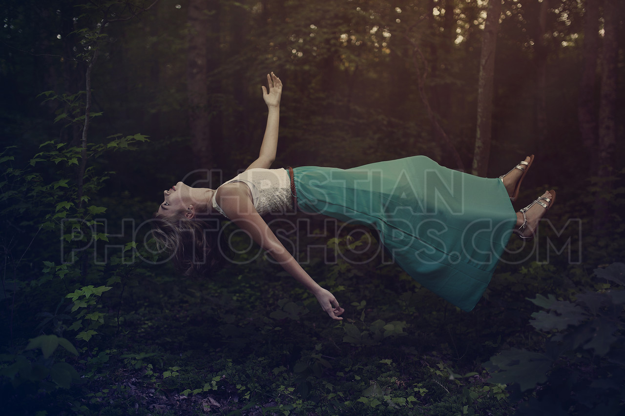 A woman levitates in the forest