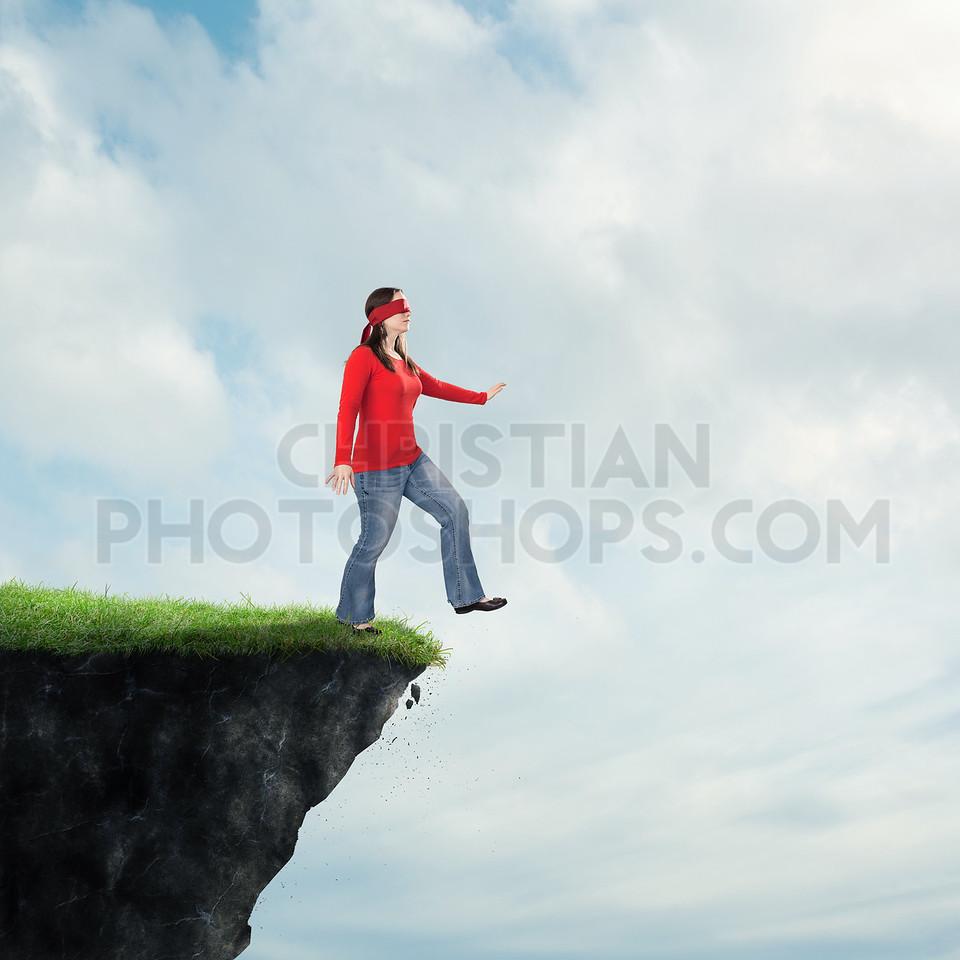 Woman walking off cliff
