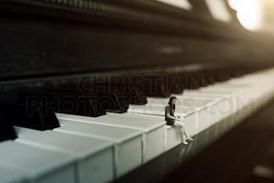 Woman on a piano