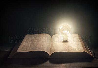 Light bulb and Bible