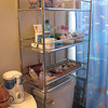 Moving the shelf unit from the remodeled bathroom into this one has helped with storage issues and even looks good. I shined it all up with chrome polish!