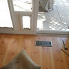 Step 10, putting in the trim. Here is the trim bewteen the floor and the new slider ...
