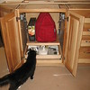 Blackie checks out the Kitchen Aid cabinet.