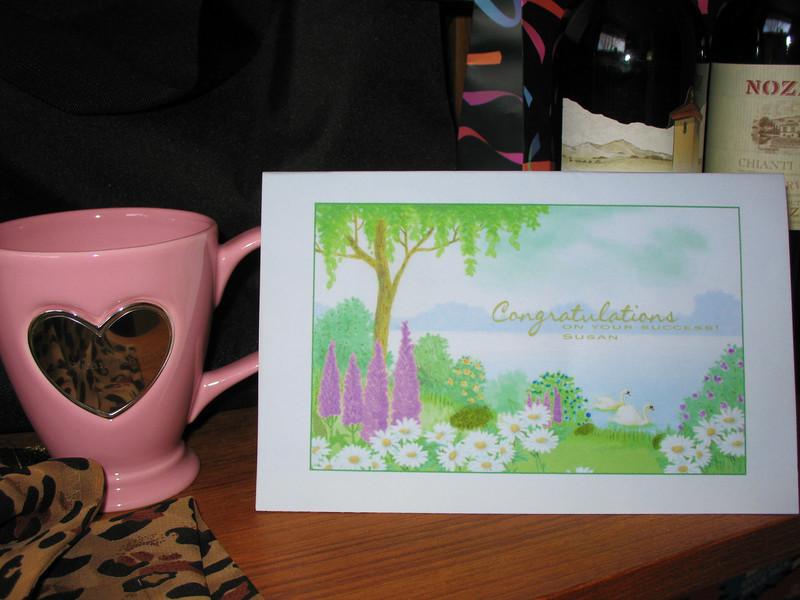 A closeup of the Dr. Susan Schmid cup and the Lucy Kovacs original card.
