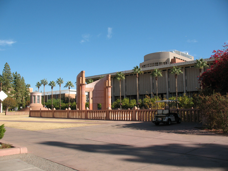 Headed toward the library...the square building behind the palms is the library tower but you get in by going down....
