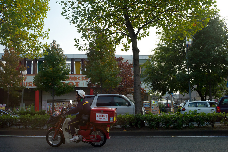 Japan Post delivery bike, shot from the back of a taxi