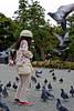Girl feeding the pigeons - Tsurugaoka Hachimangu, Kamakura