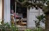 Enjoying the afternoon paper - Kamakura