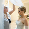 Here comes the veil to complete the look.