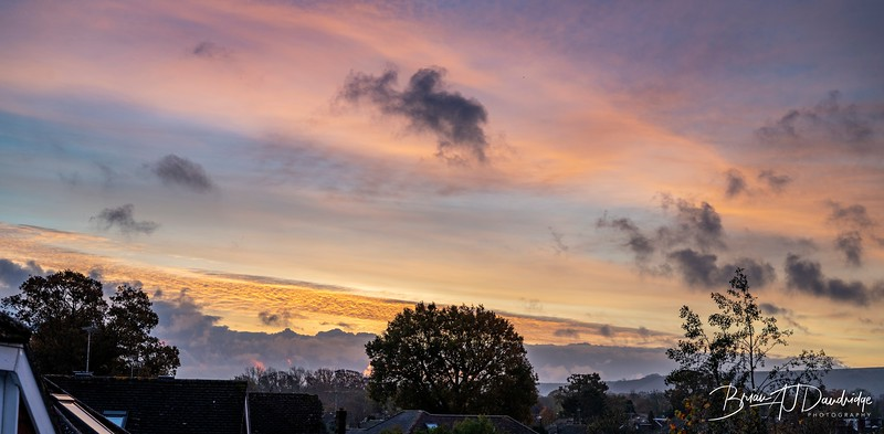 """Lock-down, Day 7.   One minute you think it's not going to happen and then """"Wow, nearly missed it, again!"""".  Once again, still in my PJs, enjoying the first cup of tea, then had to grab the camera and rush out on the balcony to catch this morning's sunrise-skies."""