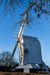 Oldland Mill with its sweeps set towards the sinking sun