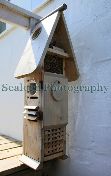 Bug hotel attached to the side of a home in Guernsey, Channel Islands