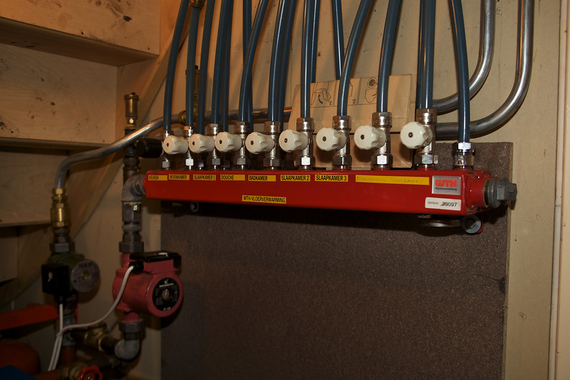 Plumbing for central heating in an ecohome in Stavoren, The Netherlands