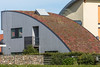 A curved sedum roof on a house in Texel, The Netherlands