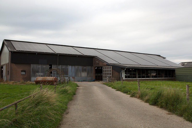 """German farm building with photovoltaic panels photographed on 11 August 2011<br /> ©RLLord <br /> File No. 110811 8973<br /> sustainableguernsey@gmail.com<br /> <a href=""""http://www.sustainableguernsey.info/blog/"""">http://www.sustainableguernsey.info/blog/</a>"""