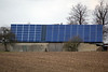 photovoltaic panels on farm building near Goch Germany 040112 ©RLLord 9758 smg