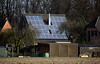 photovoltaic panels on house roof near Weeze airport 080112 ©RLLord 0177 smg
