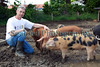 "Guernsey smallholder Kevin Driscoll with some of his Oxford Sandy and Black pigs on 28 May 2010.<br /> <br /> File No. 280510 9607<br /> All Rights Reserved©RLLord<br /> <br /> <a href=""http://www.sustainableguernsey.info/blog/"">http://www.sustainableguernsey.info/blog/</a><br /> sustainableguernsey@gmail.com"