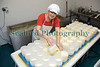 "Fenella Maddison pouring curd into moulds in her Guernsey cheese processing room on 16 November 2009.<br /> <br /> File No. 161109<br /> <br /> All Rights Reserved©RLLord<br /> <br /> <a href=""http://www.sustainableguernsey.info/blog/"">http://www.sustainableguernsey.info/blog/</a><br /> <br /> sustainableguernsey@gmail.com"
