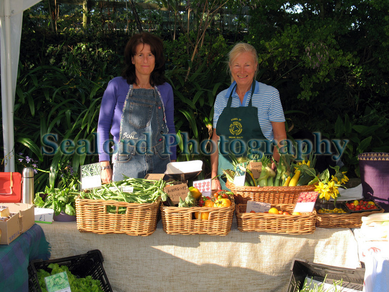 The Guernsey Climate Action Network (G-CAN) stall set-up at the Sausmarez Manor Farmers' Market in Guernsey on the 20 September 2008.  The fresh, locally grown vegetables are supplied by Guernsey Organic Growers.  The G-CAN stall sells also freshly baked Senners Bread.<br /> File No. 200908 785<br /> RLLord<br /> fishinfo@guernsey.net