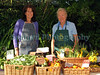 The Guernsey Climate Action Network (G-CAN) stall set-up at the Sausmarez Manor Farmers' Market in Guernsey on the 20 September 2008. The fresh, locally grown vegetables are supplied by Guernsey Organic Growers. The G-CAN stall sells also freshly baked Senners Bread.<br /> File No. 200908 786<br /> RLLord<br /> fishinfo@guernsey.net