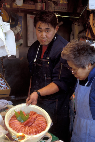 A container of salted Alaska pollock roe called tarako held by a middleman or intermediate wholesaler at the Tsukiji Fish Market in December 1988.  Alaska pollock, Theragra chalcogramma, is one of the world's most plentiful commercial fish species.<br /> File No. 1288 15<br /> ©RLLord<br /> fishinfo@guernsey.net