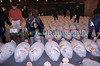 Frozen tuna on display prior to auction at the Tsukiji wholesale fish market in Tokyo, Japan.  Tuna buyers are inspecting meat quality.<br /> Photographed on 28 March 2002<br /> File No. 3-543<br /> ©RLLord<br /> fishinfo@guernsey.net