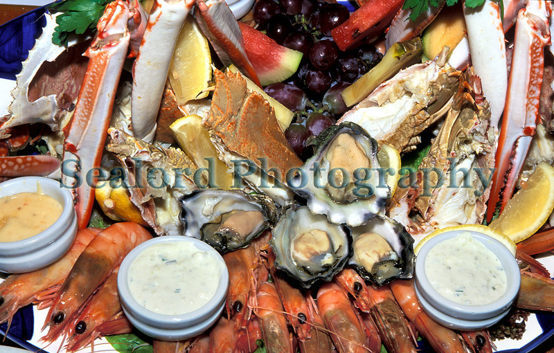 A seafood platter photographed near Brisbane in Queensland, Australia.  The platter consists of prawns; oysters; swimming crabs; Morton Bay bugs, Thenus orientalis; and fruit.<br /> File No. 36-382<br /> ©RLLord<br /> fishinfo@guernsey.net