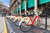 BikeMi rental station for regular and electric bicycles in Piazza del Duomo, Milan, Italy
