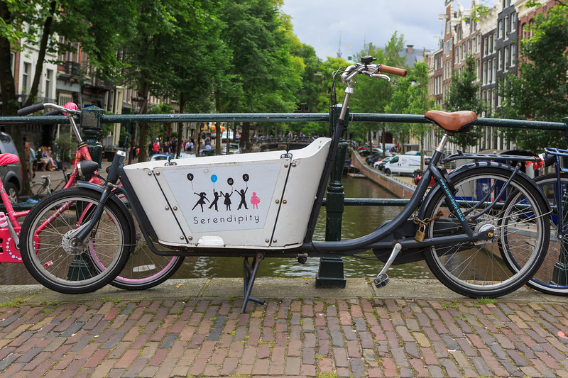 Serendipity Kid's cargo bike parked over an Amsterdam canal