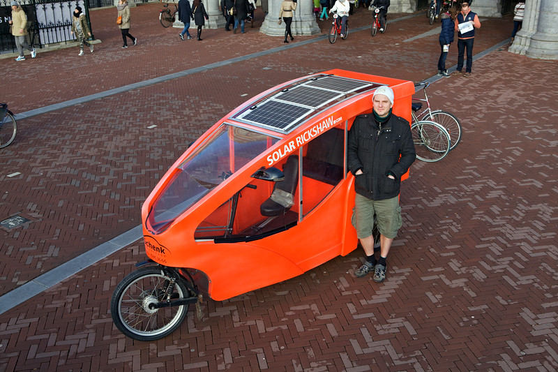 Thomas Lundy of the Solar Rickshaw outside the Rijksmuseum in Amsterdam on Sunday 5 January 2014
