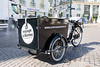 Electric tricycle parked in Place Royale used to promote Nantes and the surrounding area