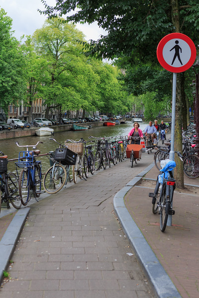 Bicycle road along a canal in Amsterdam, The Netherlands