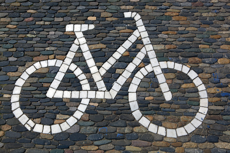 Bicycle path sign in cobbles in Freiburg, Germany