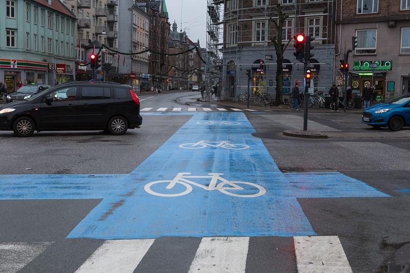 The bicycle lane along Nørrebrogade crossing Jagtvej, Copenhagen