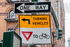 Turning vehicles yield to bicycles road sign in New York City
