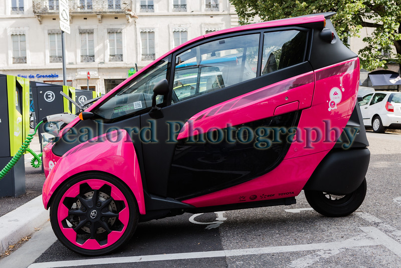 Toyota i-Road electric vehicle charging in Grenoble, France